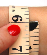 Bracelet Sizing with a measuring tape.